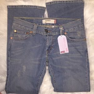 Levi's 504 distressed slouch jeans. Size 11. NWT.